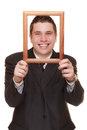 Business man framing his face with wood frame Royalty Free Stock Photo