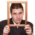 Business man framing his face with wood frame nerdy funny guy wooden empty picture isolated on white background Stock Images