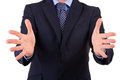 Business man gesturing with both hands Stock Photos