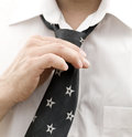 Business man getting ready for work fixing his tie Royalty Free Stock Photo