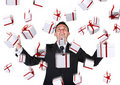 Business man with gifts falling down Stock Photo