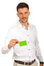 Business man giving green card blank isolated on white background Stock Image