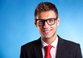 Business man with glasses smiling Royalty Free Stock Photo