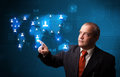 Business man with glowing media icons businessman standing and choosing from social network map Stock Photo
