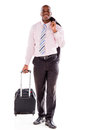 Business man going on a trip carrying bag isolated over white Royalty Free Stock Image