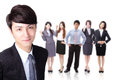 Business man with group team young successful men behind him isolated on white background asian model Royalty Free Stock Photo