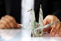 Business man hand holding origami paper cranes money concept Stock Photography