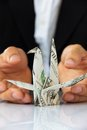 Business man hand holding origami paper cranes money concept Royalty Free Stock Photo