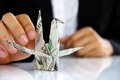 Business man hand holding origami paper cranes money concept Stock Photo