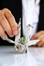 Business man hand holding origami paper cranes money concept Stock Photos