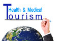 Business man hand writing health medical tourism over earth earth map furnished by nasa Royalty Free Stock Image