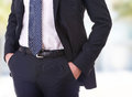 Business man with hands in pockets Royalty Free Stock Images