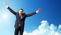 Business man happy against the blue sky Stock Images