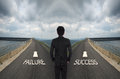 Business man has to decide between two different way choose fai failure or success road the correct Stock Photo