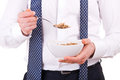 Business man having breakfast with cereal bowl Stock Images
