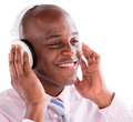 Business man with headphones listening to music isolated over white background Royalty Free Stock Photo