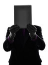 Business man hiding behind digital tablet silhouette one caucasian senior holding white background Stock Image