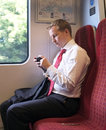 Business man with his tablet pc returning home after work on a london overground train Royalty Free Stock Images