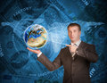 Business man hold Earth. World map and money on Royalty Free Stock Photo