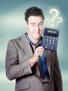 Business man holding calculator. Money question Royalty Free Stock Photo