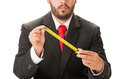 Business man holding a centimeter with black suit and red necktie Stock Photography