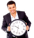 Business man holding a clock Stock Images