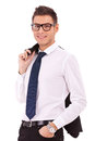 Business man holding coat over shoulders Stock Photography