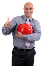 Business man holding contruction helmet Stock Images