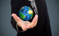 Business man holding earth  (Elements of this image f Royalty Free Stock Photo
