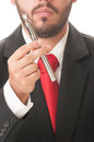 Business man holding an electronic cigarette Royalty Free Stock Photo