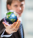 Business man holding globe in hand Royalty Free Stock Photo