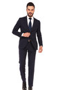 Business man holding hand on suit`s button is stepping forward Royalty Free Stock Photo
