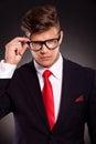 Business man holding his eyeglasses Royalty Free Stock Photo