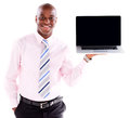 Business man holding a laptop displaying the screen isolated over white Stock Photography