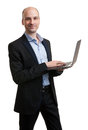 Business man holding a laptop isolated over white background Royalty Free Stock Photo