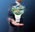 Business man holding light bulb Royalty Free Stock Photo