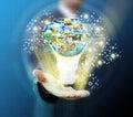 Business man holding light bulb Social Network Royalty Free Stock Photo