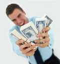 Business man holding out money isolated on white Stock Image