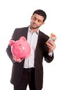 Business man holding piggy bank with money vertical portrait of a wearing a suit a and aud australian dollars thinking about Royalty Free Stock Photo