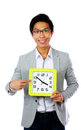 Business man holding and pointing to a big clock time Stock Photos