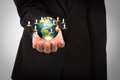 Business man holding the small world in his hands Royalty Free Stock Photography