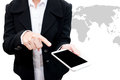 Business man holding smart phone with world map graphic in backg Royalty Free Stock Photo