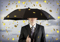 Business man holding an umbrella, money falling Royalty Free Stock Photo