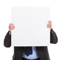 Business man holds a pannel in front of his face holding blank board on white background Royalty Free Stock Images