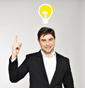 Business man with an idea bulb young handsome Stock Photography