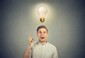 Business man with idea solution and light bulb over head Royalty Free Stock Photo
