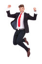 Business man jumping ecstatic young in the air and cheering loud isolated on white background Stock Photos