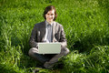 A business man with a laptop on the grass field Royalty Free Stock Photo