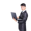 Business man with a laptop isolated over white background Stock Photo