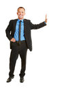 Business man leaning on imaginary wall smiling full body isolated Stock Photo